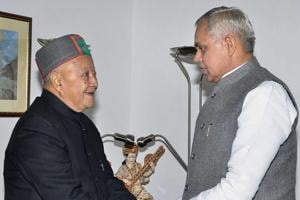 Outgoing Chief Minister Virbhadra Singh meets Governor Acharya Devvrat to submits his resignation, at Raj Bhawan in Shimla on Tuesday.