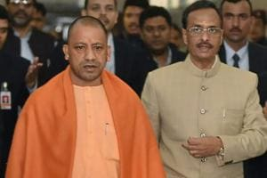 Uttar Pradesh CM Yogi Adityanath and Deputy CM Dinesh Sharma on their way to attend the winter session of UP Assembly, in Lucknow on Tuesday.