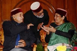 BJP central observer Nirmala Sitharaman talks with the former chief minister and senior leader Prem Kumar Dhumal during a meeting with the newly elected party MLAs in Shimla on Thursday.