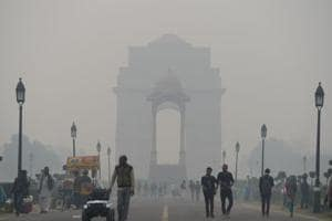 Indian residents walk amid heavy smog at India Gate in New Delhi.