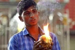 A Sri Lankan ethnic Tamil boy prays during a Hindu temple procession marking the Pongal festival in Colombo.