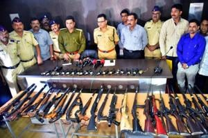 Nashik rural police with the seized arms near Chandwad toll naka on Agra-Mumbai highway.
