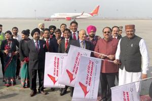 Vijay Sampla (R), Rajya Sabha MP Shwait Malik with Air India staff members during the flagging off of the Amritsar-Nanded flight from Sri Guru Ram Das Jee International Airport in Amritsar on Saturday.
