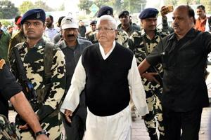 RJD chief Lalu Prasad seen at Patna airport before leaving for Ranchi on Friday.