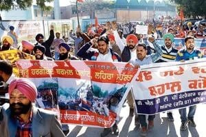 Employees of Guru Nanak Dev Thermal Plant and other unions protesting opposite the office of Punjab finance minister Manpreet Singh Badal in Bathinda on Saturday.