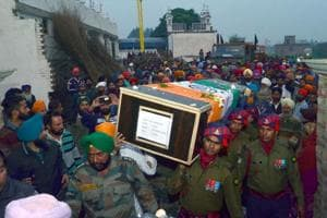Army personnel carrying the coffin of martyr Lance Naik Gurmail Singh in his village, Alkare, on Sunday.