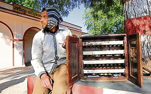 Mahendra Kumar uses a portable chest to sell tickets at the Rashidpur Khori railway station in Rajasthan.