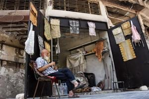 'I lost myself': In rubble of Aleppo souk, tablecloth shop makes...