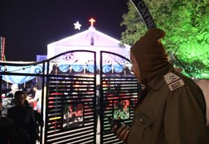 A cop guards Christmas celebrations in Bhopal on Sunday night.