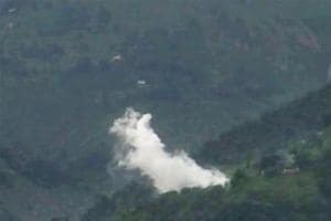 Smoke rises after a mortar shell is fired by the Pakistani Army near the Line of Control at Shahpur and Degwar areas, in Jammu and Kashmir