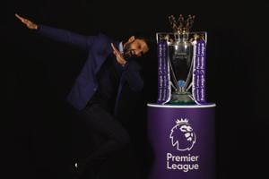 Actor Ranveer Singh poses with the Premier League Trophy  in London, England.