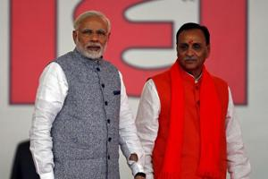 Vijay Rupani takes oath as Gujarat CM; Patidars, OBCs get equal...