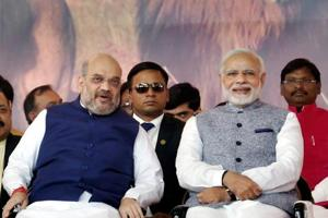 Prime Minister Narendra Modi and BJP president Amit Shah during the swearing-in ceremony of the new Gujarat government in Gandhinagar on Tuesday.