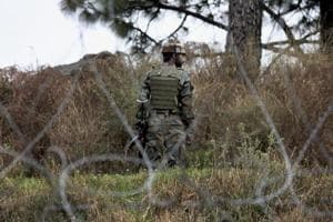 An Indian Army jawan patrols along the Line of Control (LOC) in Jammu and Kashmir.