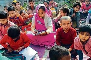 Midday meal cook learns to read and write with children, turns...