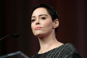 Actor Rose McGowan addresses the audience during the opening session of the three-day Women