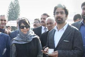 Jammu and Kashmir governor N N Vohra (left)along with chief minister Mehbooba Mufti and her brother Tassaduq Hussain Mufti after the swearing-in ceremony of the newly inducted ministers at Raj Bhavan in Jammu on Thursday.