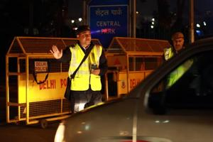 A policeman halts a car during an integrated drive where Delhi Police, Delhi Traffic Police and others checked the citizens lest they drink drive.