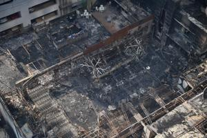 Charred remains of the restaurants at Kamala Mills compound, Lower Parel.
