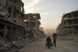 Photos: Few takers for massive bill to rebuild Iraq after ISIS