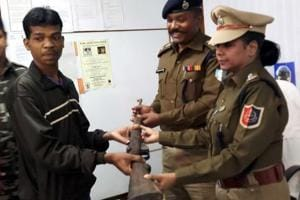 A Maoist cadre surrenders before West Midnapore superintendent of police  Bharti Ghosh.