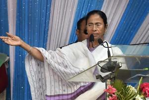 West Bengal Chief Minister Mamata Banerjee speaks during a programme to distribute cheques to the farmers for the loss of their crops in the floods, at Sagar Island on Wednesday.