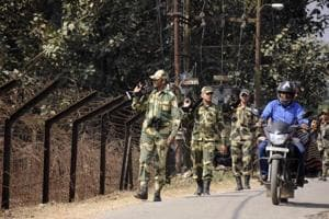 Border Security Force (BSF) personnel take part in a routine patrol near the India-Bangladesh border in Lankamura, on the outskirts of Agartala in Tripura.