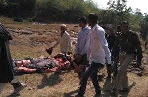 Injured trekker Shravan Sawant being carried in a makeshift stretcher.