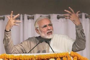Prime Minister Narendra Modi during the flag off ceremony of the Botanical Garden-Kalka Mandir section of Delhi Metro, in Noida on Monday.