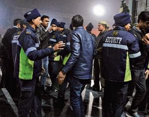 Security guards check IDs of visitors to Sahara Mall on MG Road on New Year's Eve.