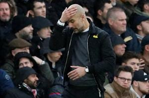 Manchester City boss Pep Guardiola calls for English referees to...