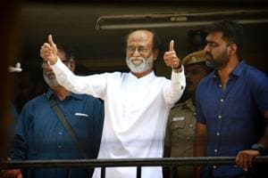 Film star Rajinikanth gestures at his fans after announcing his intention to enter politics, in Chennai on Sunday.