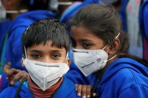Children wear air masks as they attend a demonstration to spread awareness about the effects of air pollution in Delhi.