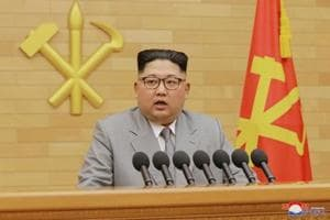 Donned in light grey, North Korea's Kim targeted softer, relaxed image...