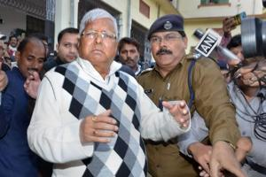 RJD supremo Lalu Prasad Yadav is escorted by police officials after being convicted by the special CBI court in fodder scam case, in Ranchi.