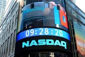 Nasdaq ends over 7,000 for 1st time, S&P 500 also hits new record