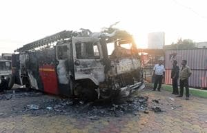 A torched fire brigade van at Bhima-Koregaon in Pune on Tuesday.