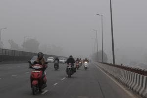 With streetlights on many stretches switched off in the morning, commuters had a tough time navigating the streets through the dense fog.