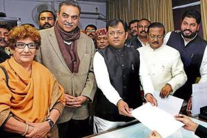 DOUBLE TROUBLE: BJP's official mayoral candidate Davesh Moudgil (centre) filing nomination along with senior deputy mayor nominee Gurpreet Singh Dhillon (second from right) at the MC office in Chandigarh on Wednesday. He is flanked by senior leader Satya Pal Jain and city BJP chief Sanjay Tandon, whose supporters had just staged a coup.