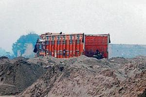 Illegal sand and gravel consignments being offloaded at the site where district Congress vice-president KC Bawa supervises the arrival from Sidhwan Bet near Ludhiana, in an office in Budhlada town of Mansa district.