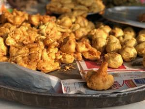 Gyan fried gigantic pakoras in a giant cauldron at his tin shop in Jangpura Extension.