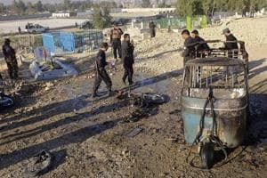 Afghan security forces inspect the site of a deadly bombing in Jalalabad province, east of Kabul, Afghanistan, Dec. 31, 2017.