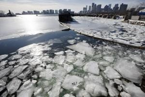 Ice floats in Boston Harbor, on January 3, 2018, in Boston. After a week of frigid temperatures, a major winter storm is predicted for the region on Thursday.
