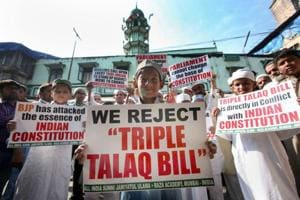 Muslims pose with placards to protest against the government over the triple talaq bill in Mumbai.
