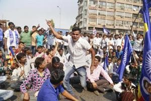Dalit protesters block a road during the Maharashtra bandh over the Bhima Koregaon violence, in Thane, Mumbai, on Wednesday.