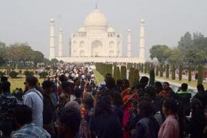 Tourists crowd at the Taj Mahal in Agra on Sunday.