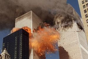 In this September 11, 2001, photo, smoke billows from one of the towers of the World Trade Center in New York.