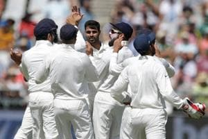 Indian bowler Bhuvneshwar Kumar (C) picked up all three South African wickets in the morning session of Day 1 of the first Test at Newlands on Friday.
