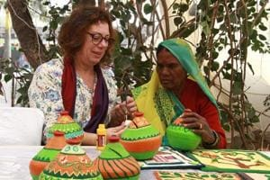 Paper-mache artists from Israel and India are working together at Delhi Haat, INA.