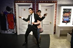 A fan poses with a wax statue of Bollywood actor Ranbir Kapoor at Madame Tussauds, Delhi.